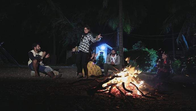 A Still Of Subba, Pranathi, Geetha, Lucky And Pinky Enjoying A Bonfire