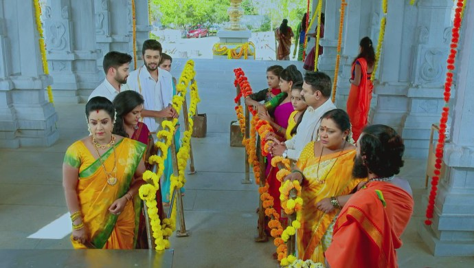 A Still Of The Vashishtas And The Manjunaths At The Temple