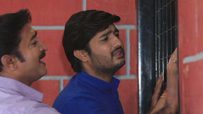 A Worried Still Of Shivu And His Father