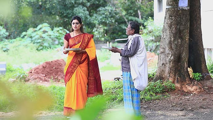 Amrutha Stands As Beggar On The Side Of The Road