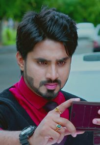 An Angry Still Of Vedanth Watching A Video