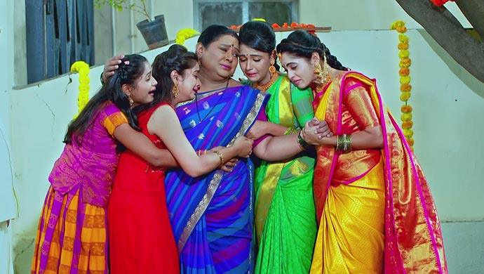An Emotional Still Of Parimala And Her Daughters