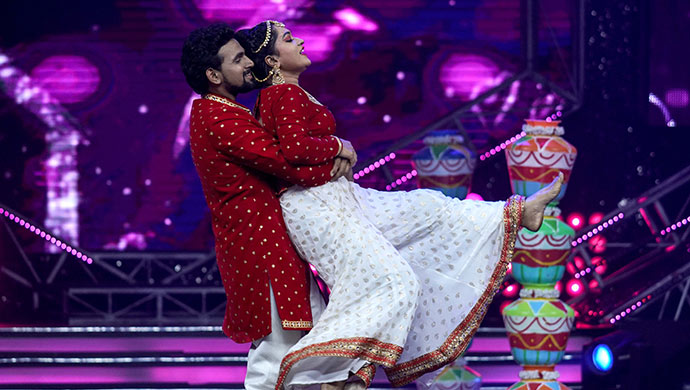 An Exclusive Still Of Ashok And Bhavani Performing On Stage