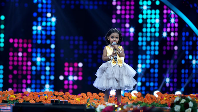 An Exclusive Still of Gnana Performing On Stage