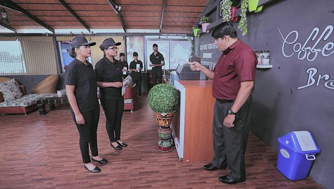 A Still Of Kamali, Ningi And The Cafe Manager