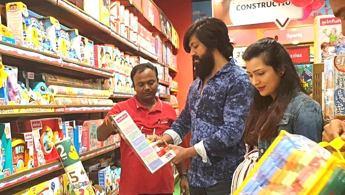 A Still Of Yash And Wife Radhika Pandit Buying Toys