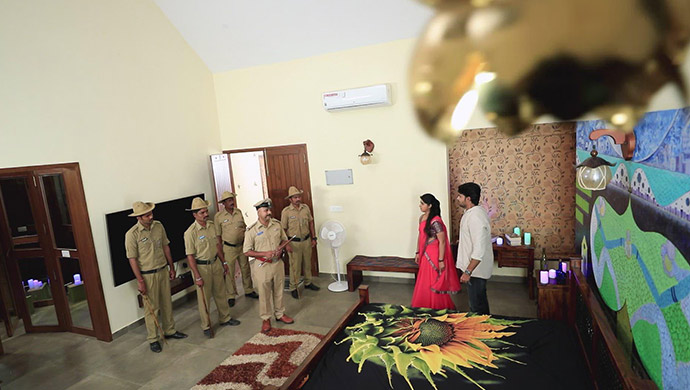 A Still Of The Cops And Radha-Krishna