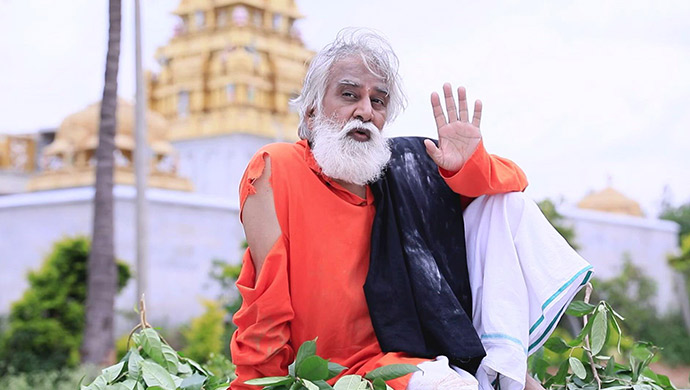 A Still Of The Old Man Outside The Temple
