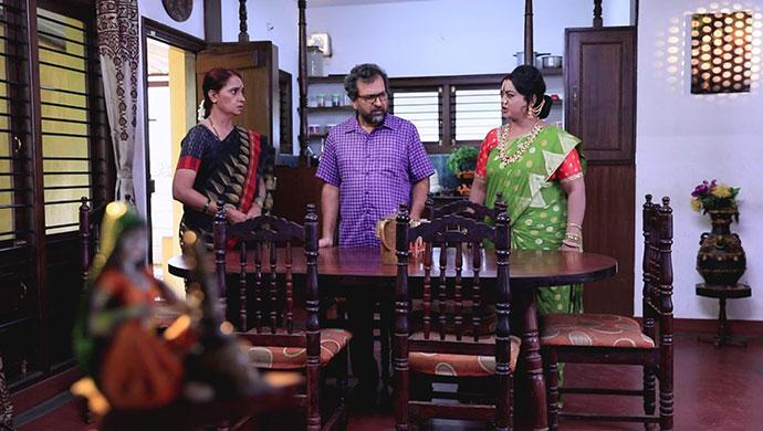 A Still Of Tulasi, Prasad And Kanthamma