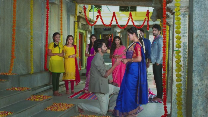 A Still Of Vicky And Aarthi Getting Engaged