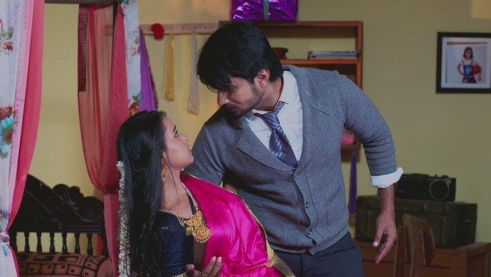 A Still Of When Amulya Falls Into Vedanth's Arms