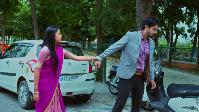 A Still Of When Amulya Holds Vedanth's Hand
