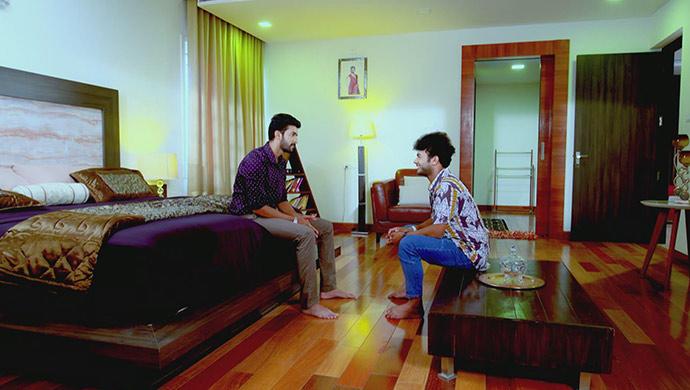 A Still Of Adi And Preethu