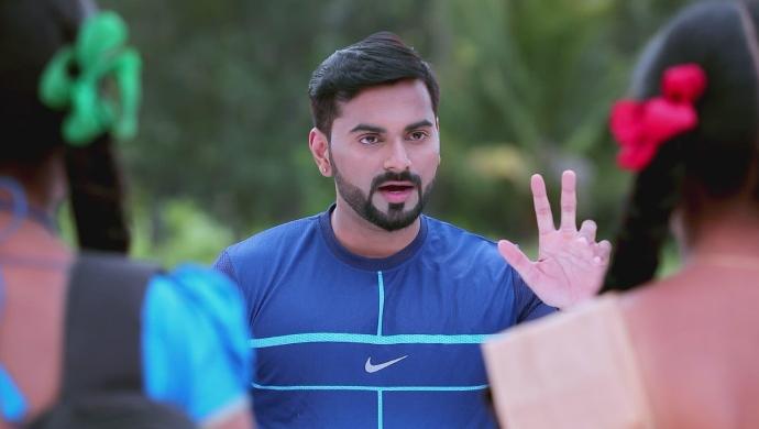 A Still Of Coach Warning Ningi And Kamali