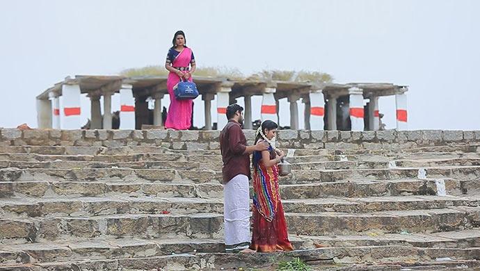 A Still Of Maya Watching Muttu And Belli