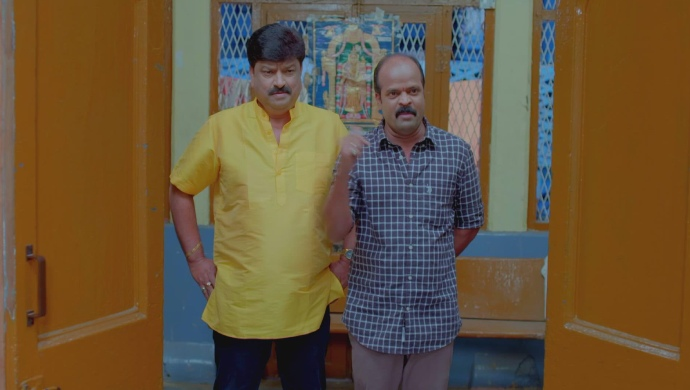 A Still Of The Saree Shop Owner And Raghupati