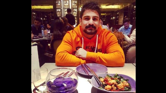 rajat tokas photographed in a restaurant