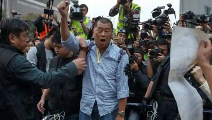 Hong Kong's Jimmy Lai Gets Hero's Welcome Upon Return To Newsroom