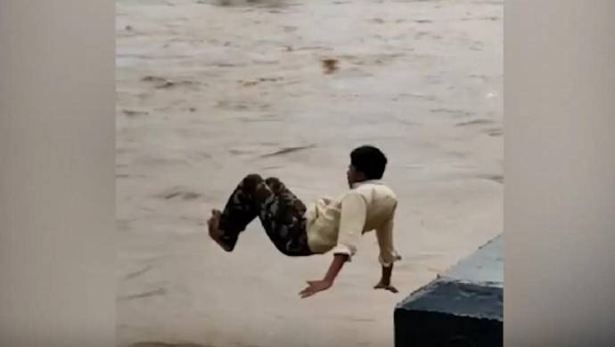 Watch: Youth Dives Into Flooded River In Bagalkot