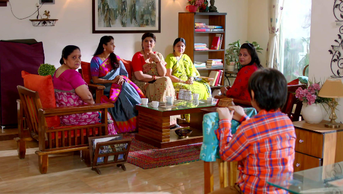 Women taunting Shubhra in her house