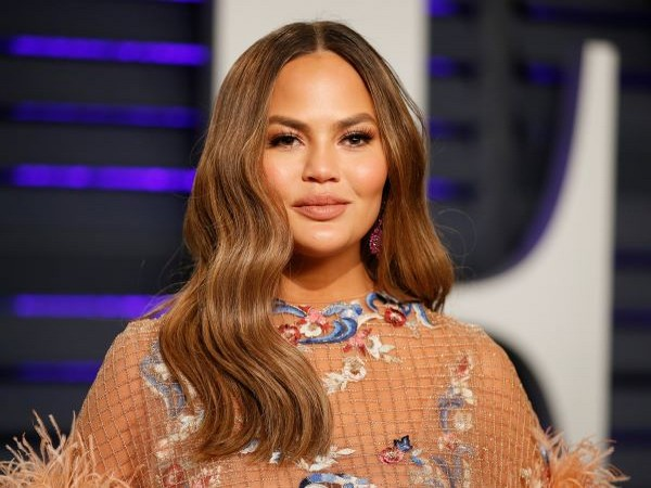 Chrissy Teigen backfires on Michael Costello, warns legal action against him