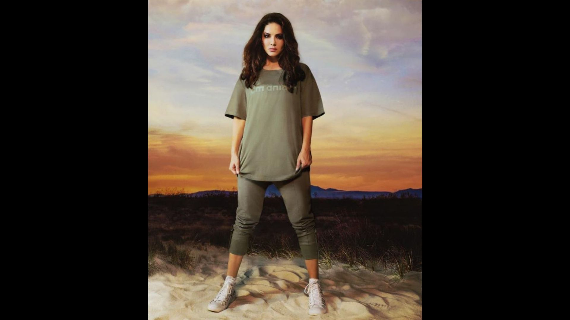 Sunny Leone's Fun And Goofy In Green Sweatshirt And Matching Pants; Her Attire Is Perfect For A Lazy Weekend