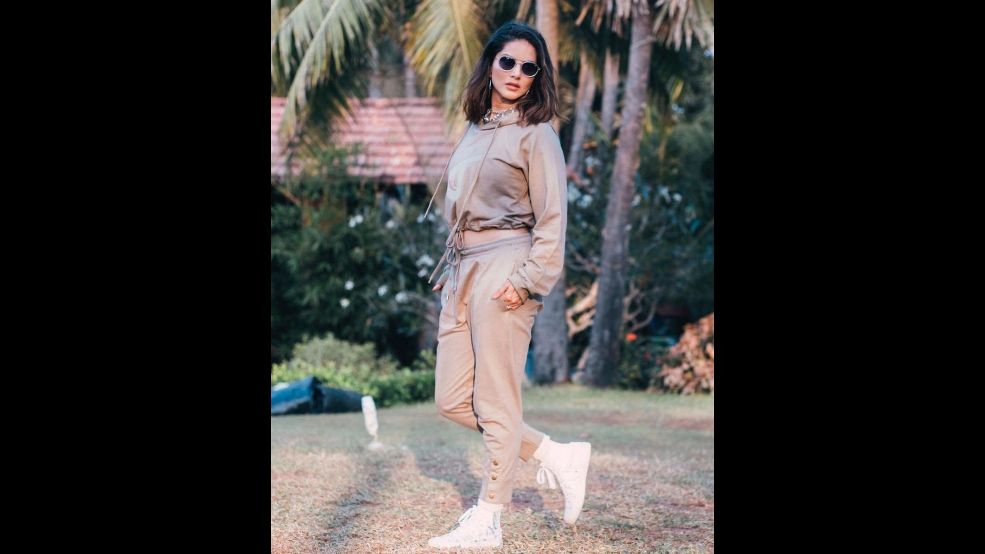 Sunny Leone Looks Cool As A Cucumber In Her Easy Breezy Hoodie And Track Pants; Shows Us A New Style And Prep For Posing
